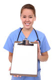 Pretty Nurse Holding Clipboard Stock Photography