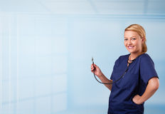 Pretty nurse in hospital listening to empty copy space with sthe Stock Photos