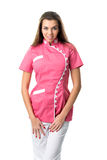 Pretty nurse in pink medical gown Royalty Free Stock Photo