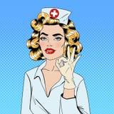 Pretty Nurse in Pop Art Style Gesturing Okay Royalty Free Stock Images