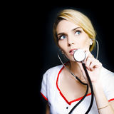 Pretty nurse ready to check a patients heartbeat Royalty Free Stock Images