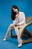Pretty nurse sitting in a chair Royalty Free Stock Images