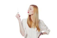 Pretty nurse with syringe Stock Photography