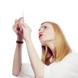 Pretty nurse with syringe Stock Image