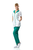 Pretty Nurse in white-green work clothing with glasses Stock Images