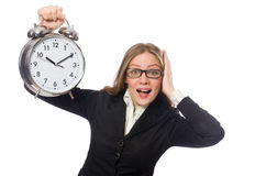 The pretty office employee with alarm clock Royalty Free Stock Photo