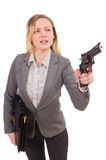 Pretty office employee with briefcase and handgun Royalty Free Stock Photography
