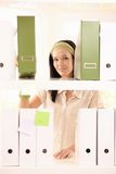 Pretty office girl arranging folders Royalty Free Stock Photo