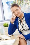 Pretty office girl on phone smiling Royalty Free Stock Photography