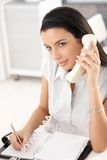 Pretty office girl working Stock Images