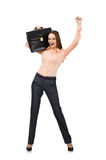 The pretty office manager holding briefcase isolated on white Royalty Free Stock Photography