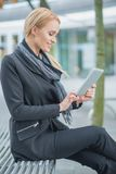Pretty Office Woman Using Her Gadget Outdoor Stock Photo