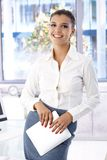 Pretty office worker standing in office Stock Photos