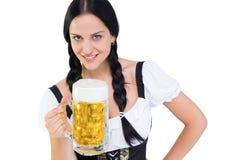 Pretty oktoberfest girl holding beer tankard Royalty Free Stock Image