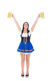 Pretty oktoberfest girl holding beer tankards Royalty Free Stock Photos