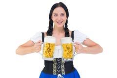 Pretty oktoberfest girl holding beer tankards Stock Photos