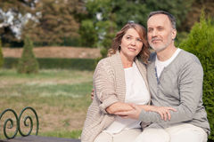 Pretty old husband and wife are resting in park stock photo