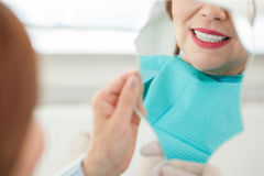 Pretty old lady is visiting her dentist Royalty Free Stock Images