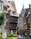 Pretty Old Town Colmar. COLMAR, FRANCE, JULY 15 2013: One of the picturesque shopping streets (Rue de Boulangers) in Colmar. This old part of town attracts Stock Photo