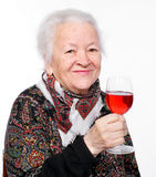 Pretty old woman with glass of wine. On a white background royalty free stock photography