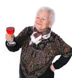 Pretty old woman with glass of wine. On a white background royalty free stock photo