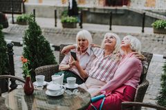 Pretty old women have rest in cafe stock images
