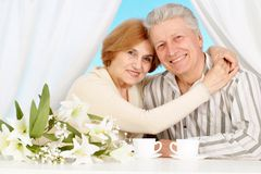 Pretty older couple resting in the bedroom Stock Image