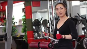Pretty oriental woman having heavy exercises stock footage