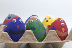 Pretty. Painted eggs in an egg box Stock Images