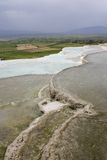 Pretty Pamukkale. Unesco world heritage site in Turkey where they try to restore these amazing natural pools Royalty Free Stock Photography