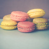 Pretty Pastel Colored French Macarons With Copy Space. Delicious Macarons With Sugar and Gold Sprinkles In Pink, Yellow and Green Royalty Free Stock Photography