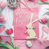 Pretty pastel Happy Easter card with lettering, tulips flowers, eggs and bunny decoration, Royalty Free Stock Photos