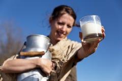 Pretty peasant woman presents fresh milk Royalty Free Stock Photo