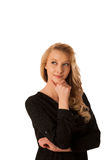 Pretty pensive caucasian blonde business woman looking into copy. Space royalty free stock image