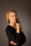 Pretty pensive caucasian blonde business woman looking into copy. Space stock image