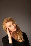Pretty pensive caucasian blonde business woman looking into copy. Space stock photography