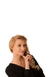 Pretty pensive caucasian blonde business woman looking into copy. Space stock photos