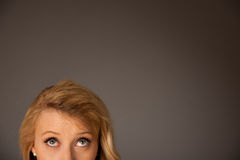 Pretty pensive caucasian blonde business woman looking into copy. Space stock photo