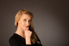 Pretty pensive caucasian blonde business woman looking into copy. Space royalty free stock images