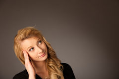 Pretty pensive caucasian blonde business woman looking into copy Royalty Free Stock Photos
