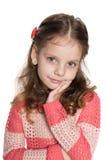 Pretty pensive little girl Stock Photo