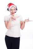 Pretty phone operator in Santa hat isolated over white Stock Photography