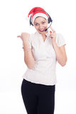 Pretty phone operator in Santa hat isolated over white Royalty Free Stock Image