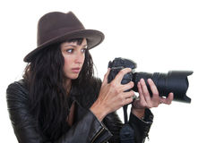 Pretty Photographer. Attractive young woman taking photos with a large DSLR Stock Photos