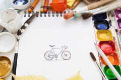 Pretty pictured bicycle with drawing supplies stock photo