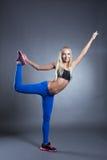 Pretty pilates instructor posing in studio Stock Photos