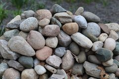 Pretty Pile of Colorful Rocks. With multicolors and some leaves good puzzle picture textures, shapes royalty free stock photo