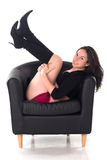 Pretty pin-up girl in chair. Smiling Royalty Free Stock Photography