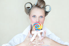 Pretty pin-up girl with a colorful candy Royalty Free Stock Image