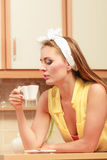 Pretty pin up girl drinking tea or coffee at home. Stock Photography